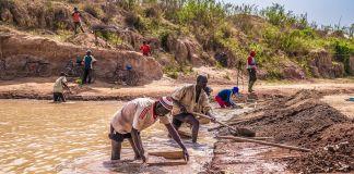 Men mining (USAID/Sandra Coburn)