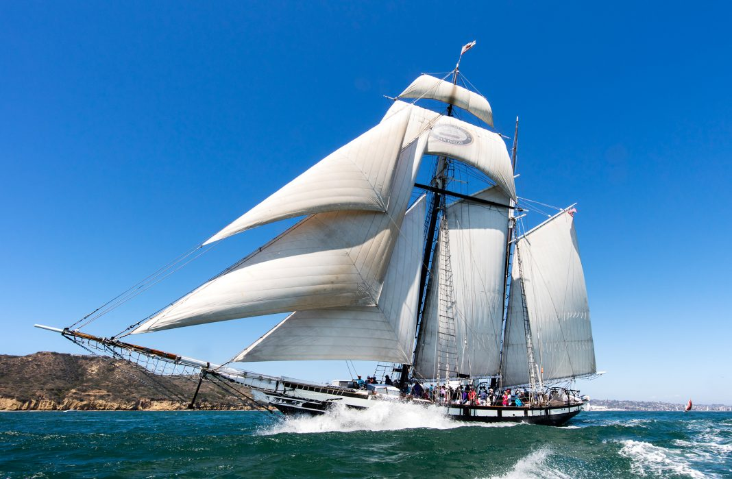 Tall ship on the water with sails full (© George Adkins/Maritime Museum of San Diego)