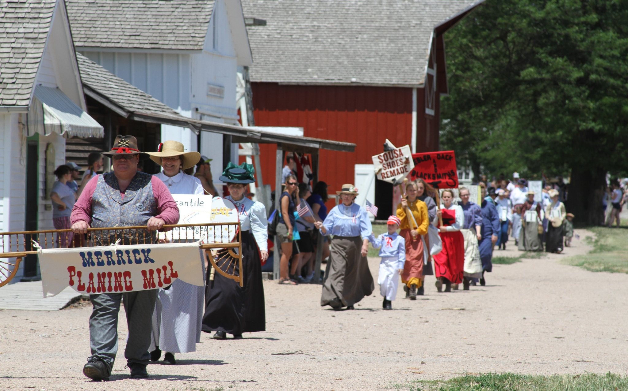 Townspeople in period clothing parading through a country town (© Stuhr Museum of the Prairie Pioneer)