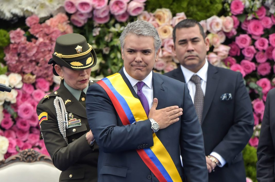 Man with hand over heart (© Raul Arboleda/AFP/Getty Images)
