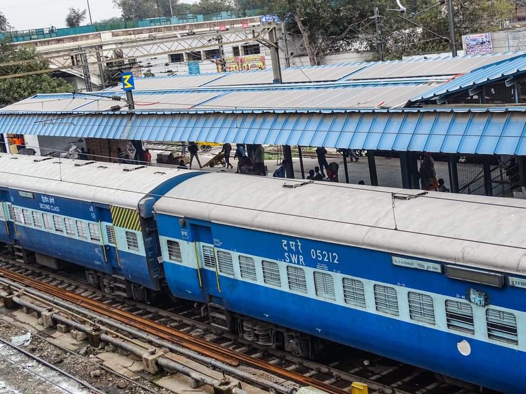 Train at railway station with solar panels over platform (USAID PACE-D TA Program)