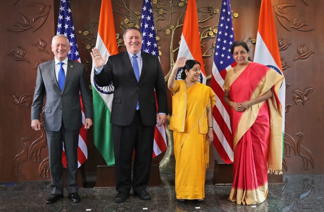Mattis, Pompeo, Swaraj and Sitharaman standing in front of flags (© Manish Swarup/AP Images)
