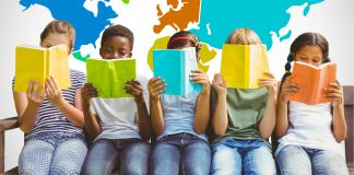 Five children in a row holding books up to their faces (© Wavebreak Media Ltd./Alamy)