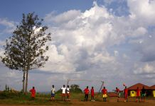 People playing on a field beneath a blue cloudy sky (© Marvi Lacar/Getty Images)