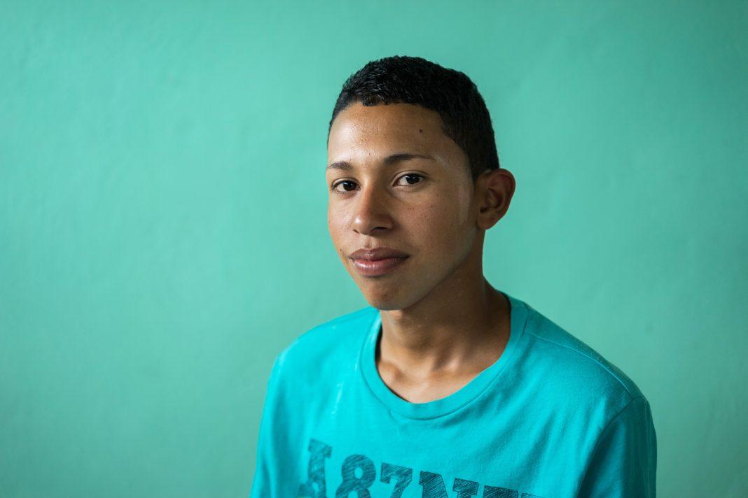 Luis posing for portrait (Thomas Cristofoletti for USAID)