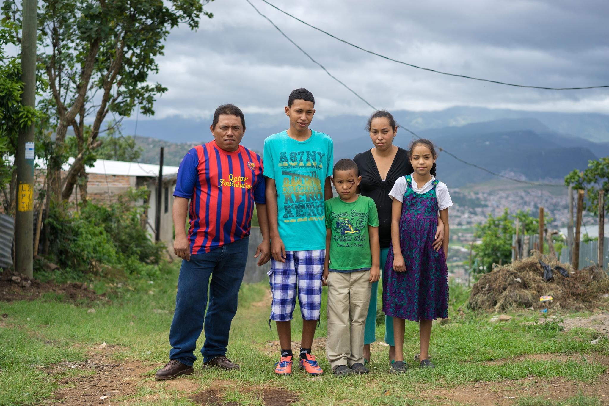 Family posing for photo (Thomas Cristofoletti for USAID)