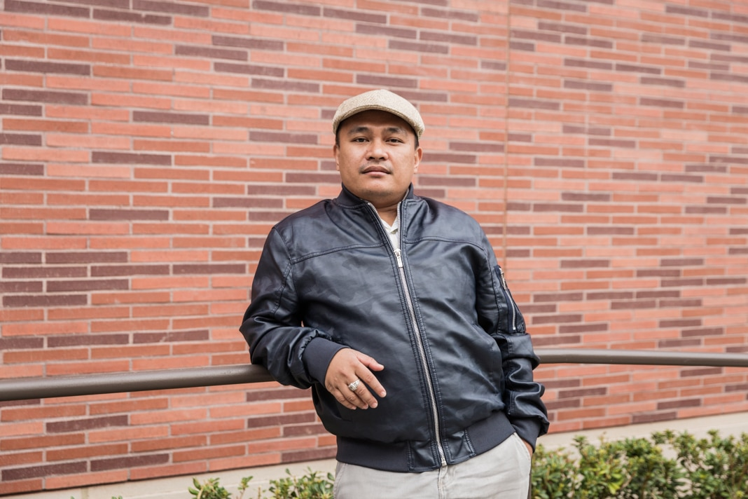 Portrait photo of man in leather jacket and hat (Emily Berl/State Dept.)