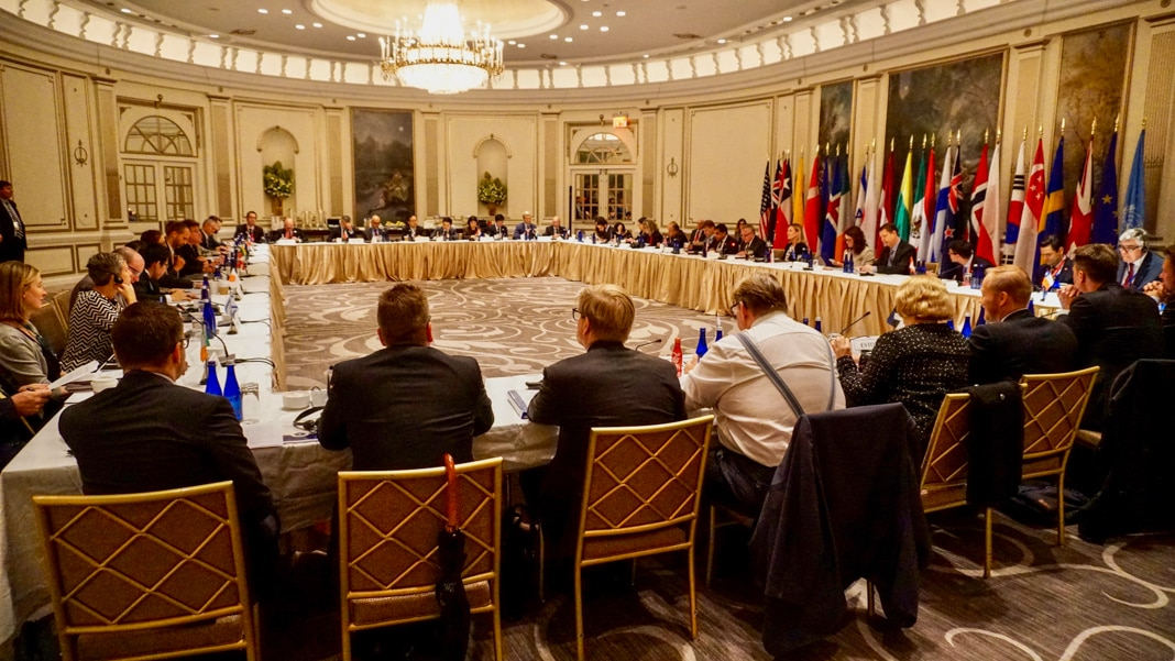 People seated around large conference table (State Dept.)