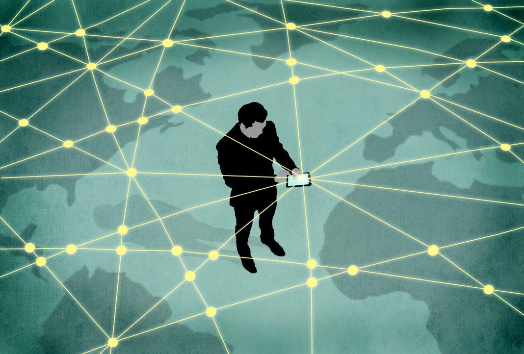 Illustration d'un homme tenant une tablette connectée à un réseau s'étendant autour du globe terrestre (Département d'État/D. Thompson)