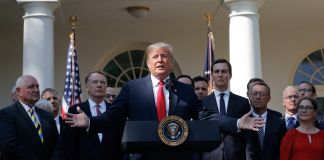 Donald Trump standing with arms outstretched behind a lectern (© Pablo Martinez Monsivais/AP Images)