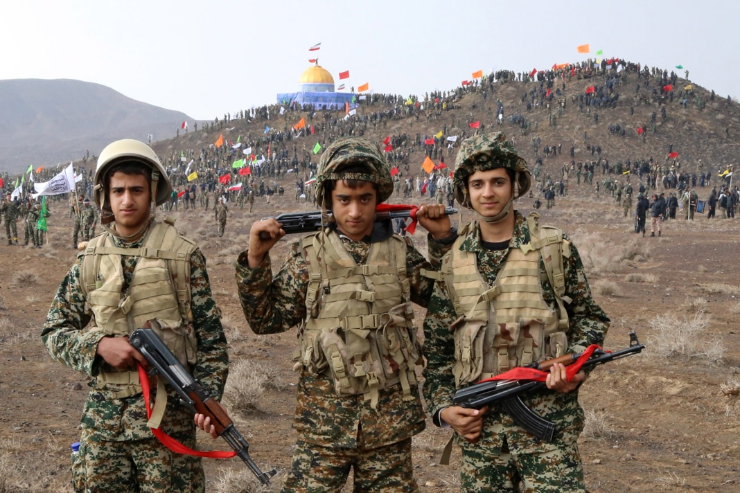Three young soldiers in battle gear (© Vahid Naderi/Fars News AgencyAP Images)