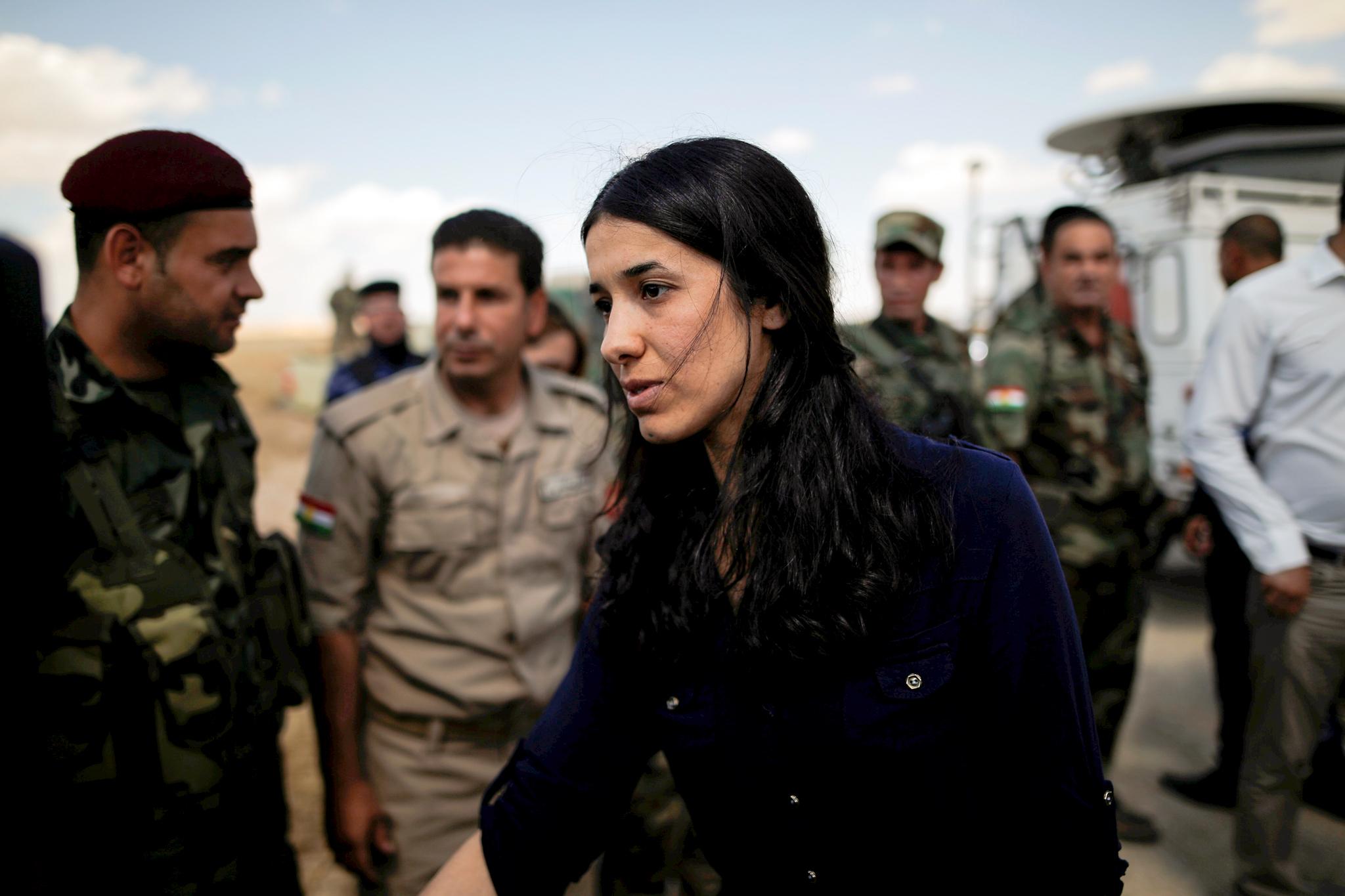 Woman standing among soldiers (© Alkis Konstantinidis/Reuters)