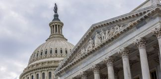 Capitol building behind Supreme Court (© Shutterstock)