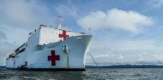 Large white ship with red crosses painted on it (U.S. Navy/Mass Communication Specialist 2nd Class Kris R. Lindstrom)