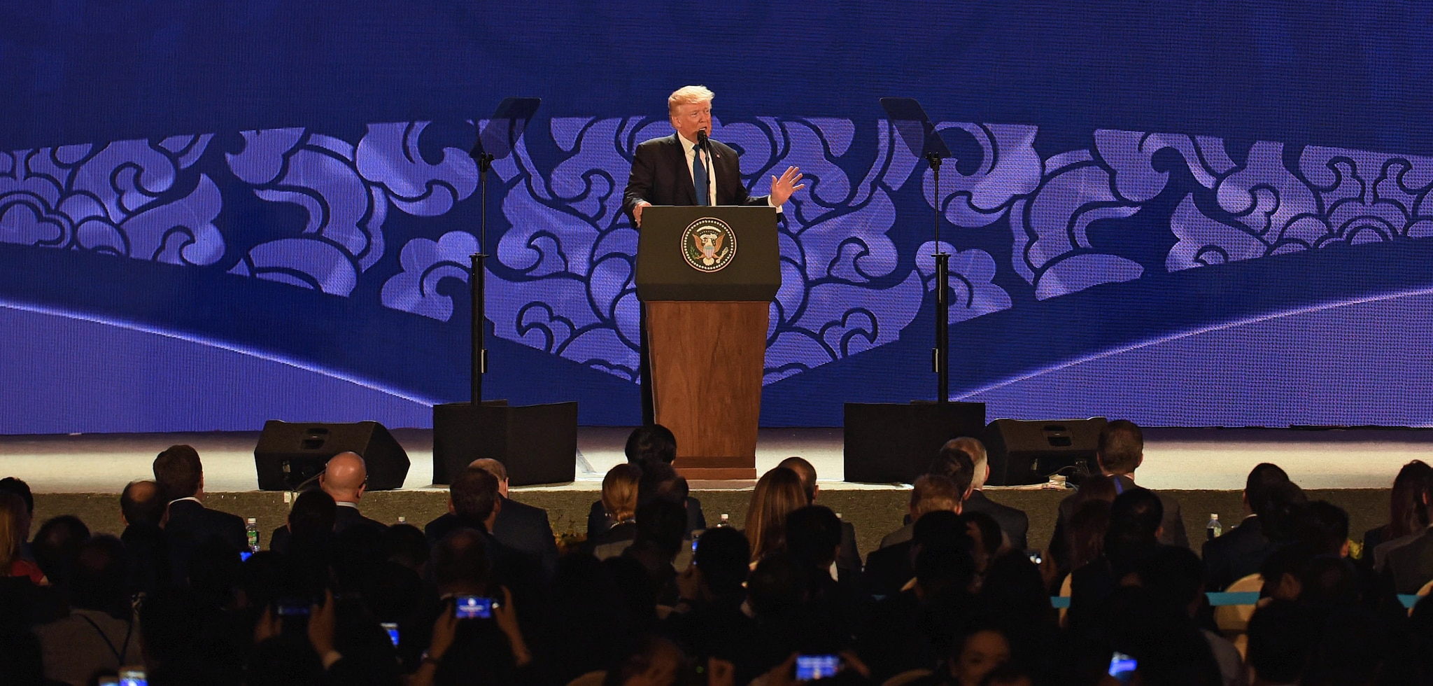 President Trump at lectern speaking in front of a group (© Anthony Wallace/AP Images)