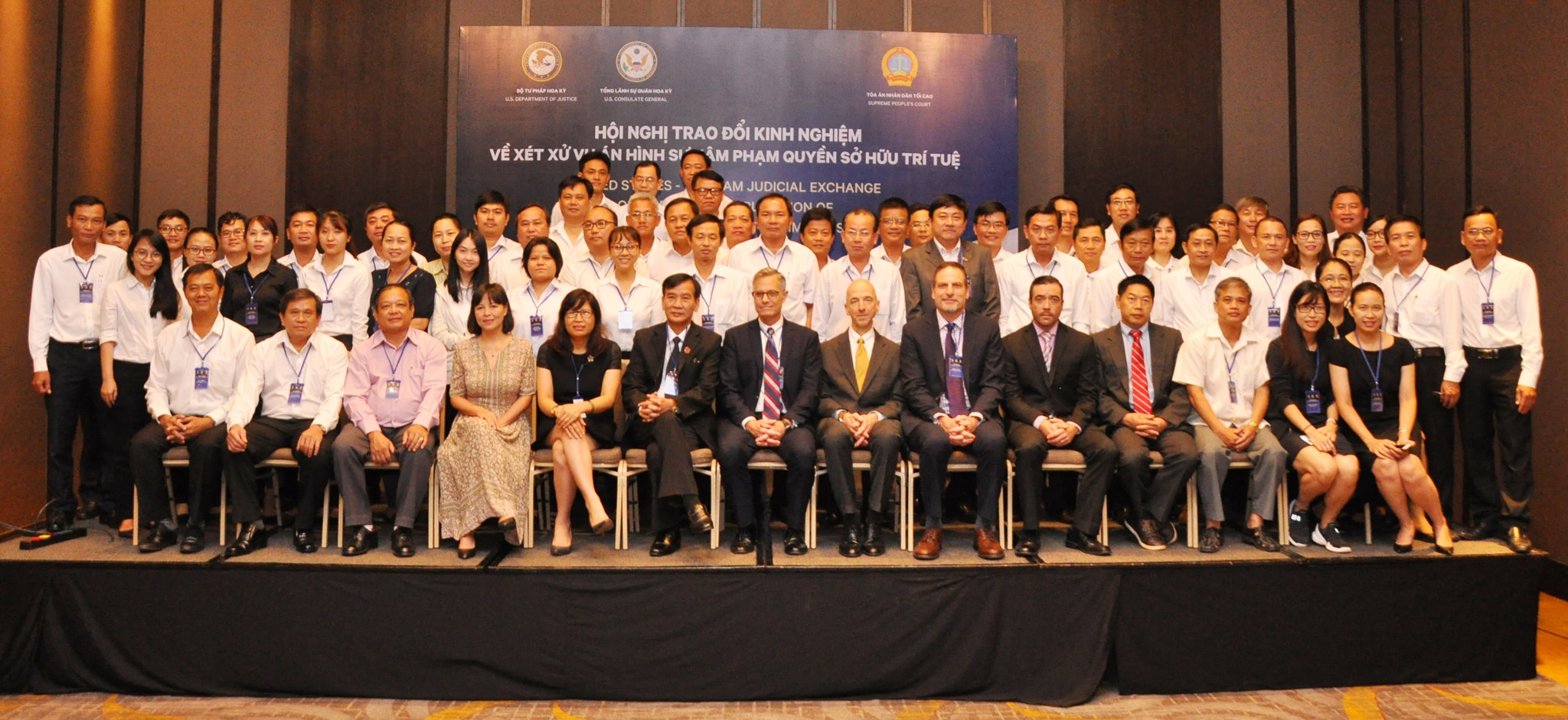 Women and men seated and standing for group portrait of workshop attendees (U.S. Consulate Ho Chi Minh City)