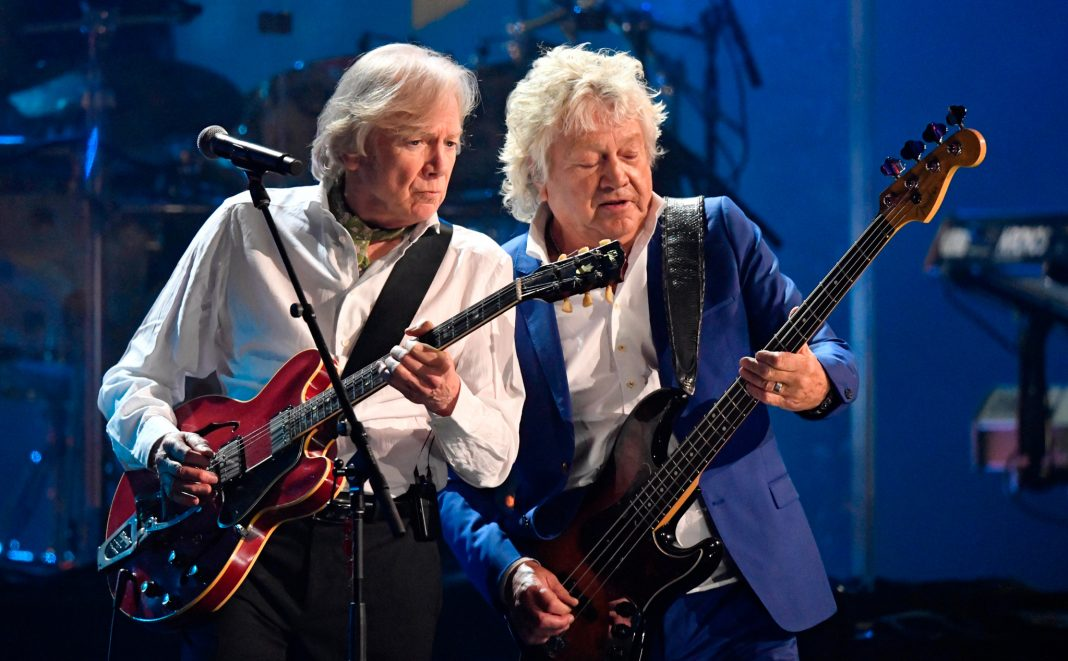 Two rock guitarists performing onstage (© David Richard/AP Images)