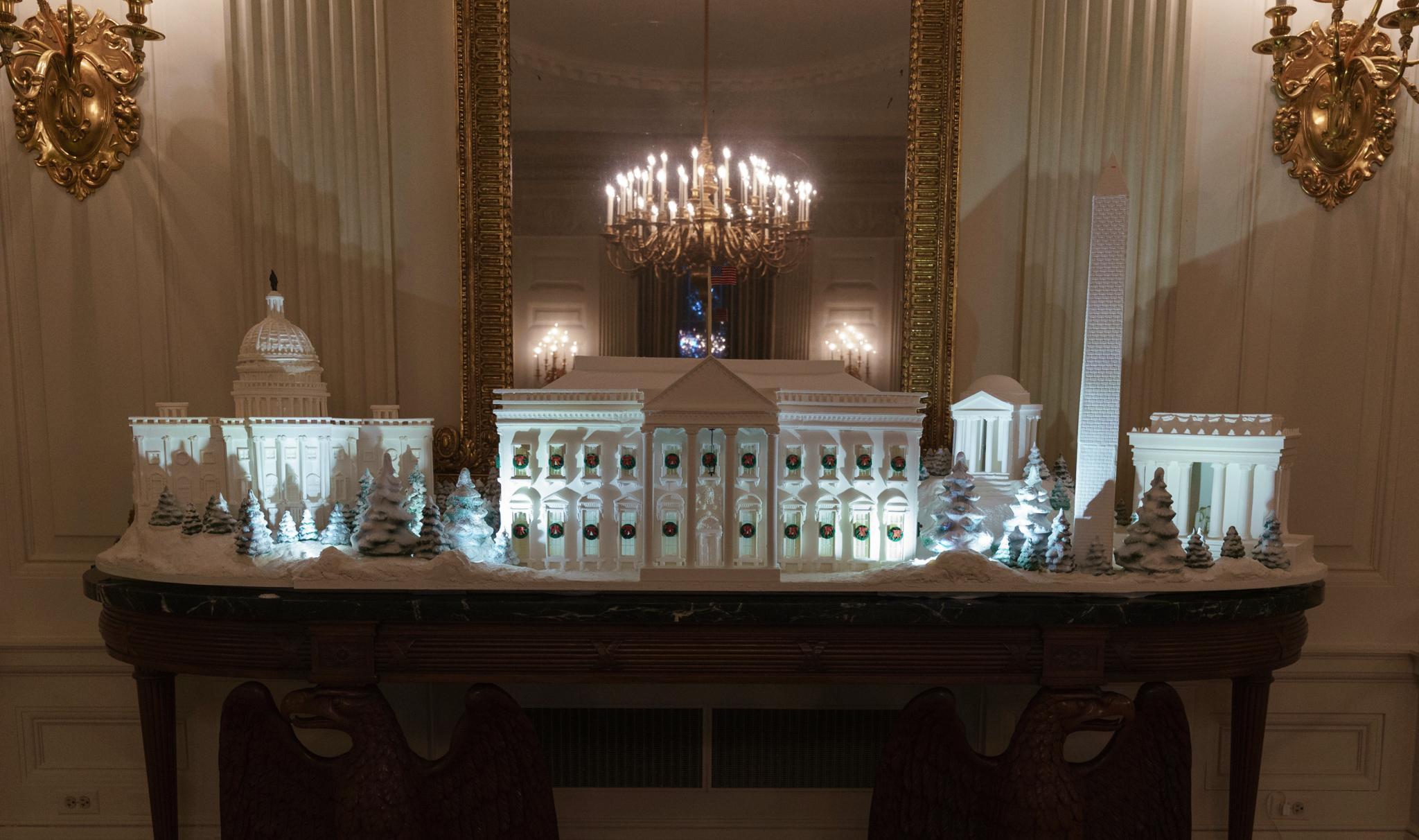 White models of buildings sitting on table (© Carolyn Kaster/AP Images)