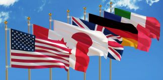 Seven country flags on flagpoles (© Shutterstock)