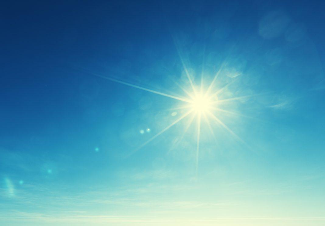 Sun in blue sky (© Lakov Kalinin/Shutterstock)