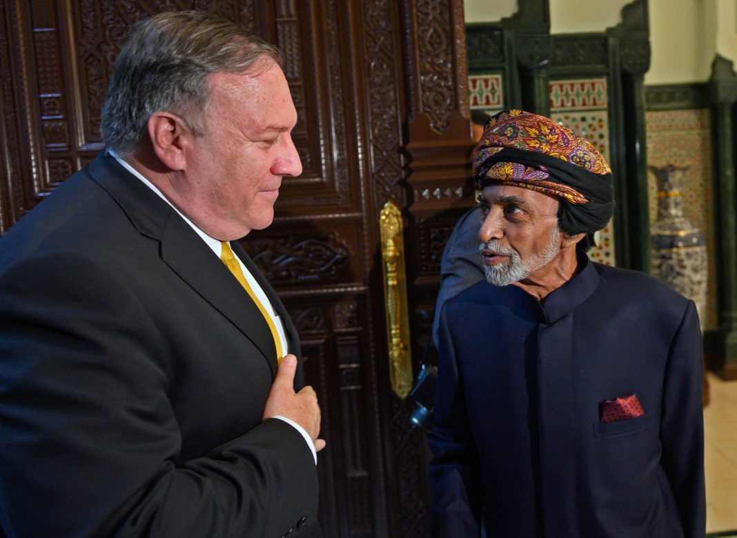 Mike Pompeo talking with Sultan Qaboos (© Andrew Caballero-Reynolds/AP Images)