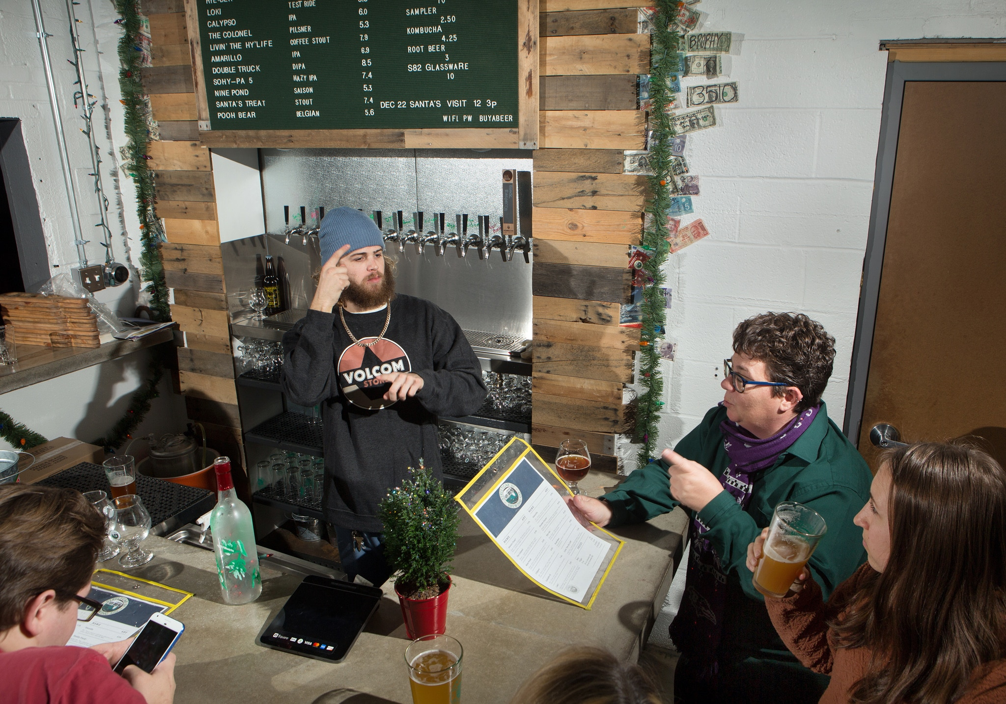 Patrons using sign language to converse with bartender (State Dept./D.A. Peterson)