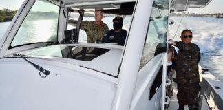 Military men in a speedboat (Luis Valladares/U.S. Embassy Guatemala)