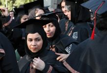 Women in academic robes (© Hasan Sarbakhshian/AP Images)