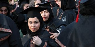 Women in academic robes (© Hasan Sarbakhshian/AP Images)