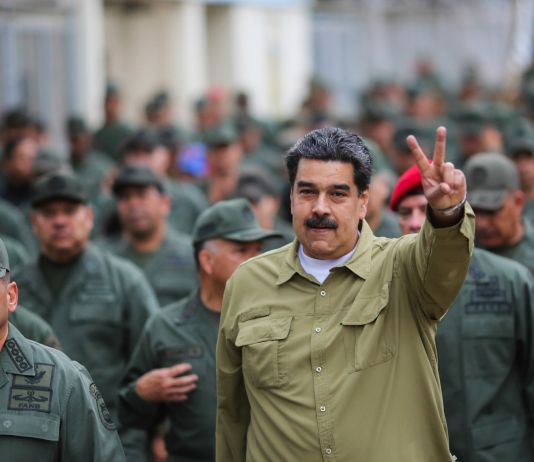 Nicolás Maduro surrounded by military personnel (© Marcelo Garcia/Miraflores Presidential Press Office/AP Images)