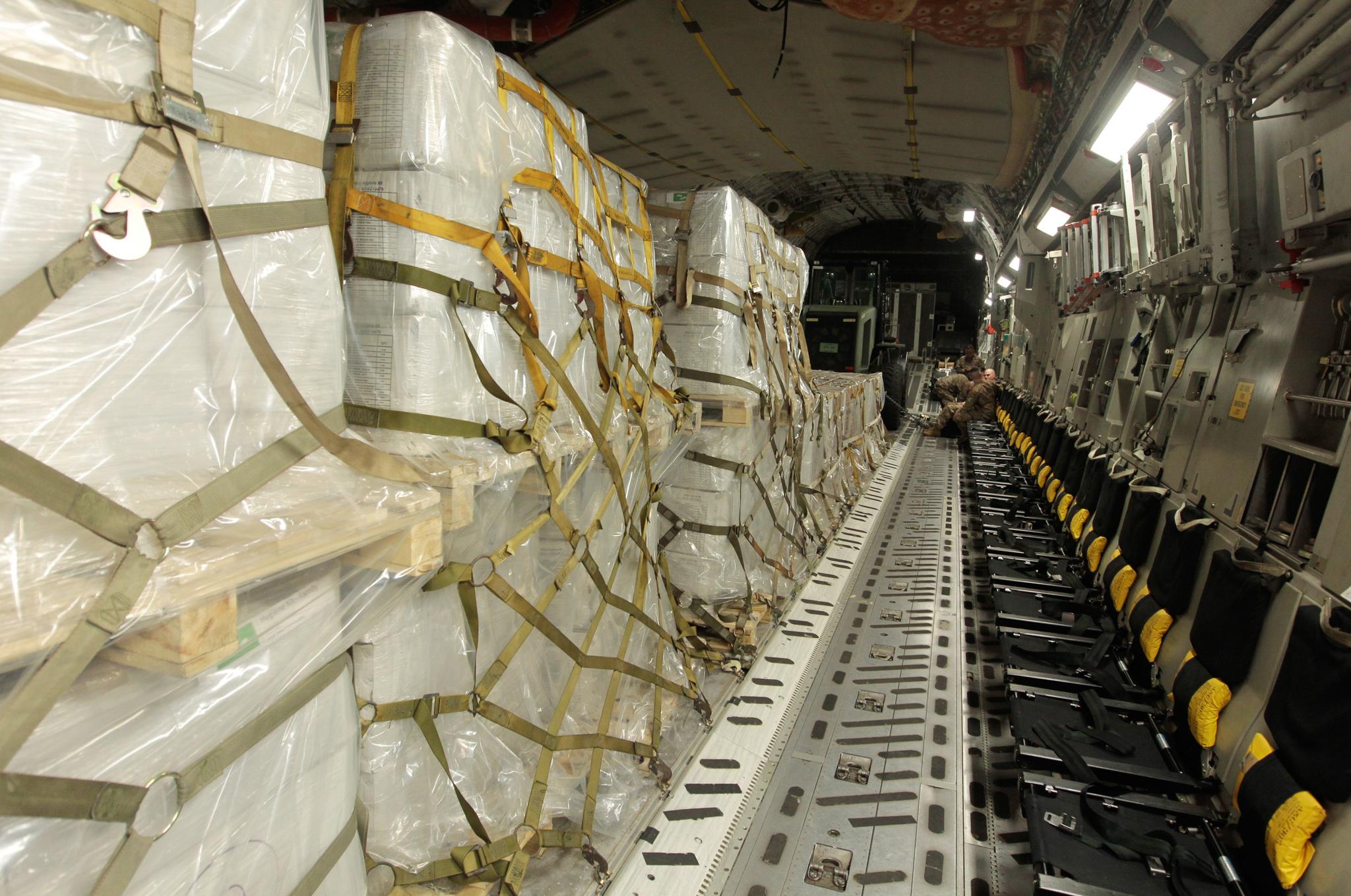 Humanitarian aid loaded inside a C-17 cargo plane (© Luis M. Alvarez/AP Images)