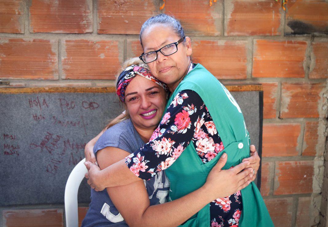 Two women hugging (Alison Harding/USAID/OFDA)