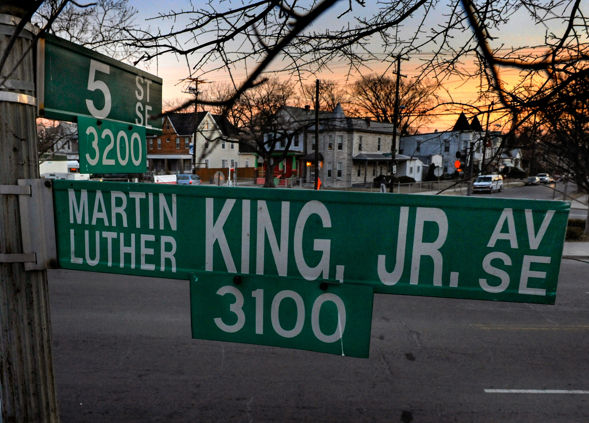 Close-up of street signs with houses in background (© Michael S. Williamson/The Washington Post/Getty Images)