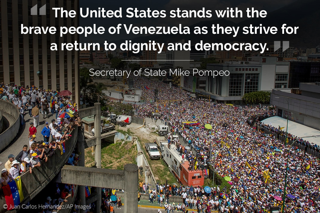 Crowd filling city streets, with quote from Secretary Pompeo overlaid (© Juan Carlos Hernandez/AP Images)
