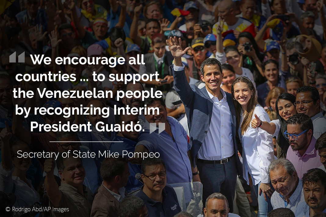 Juan Guaidó waving while surrounded by crowd, with quote from Secretary Pompeo overlaid (© Juan Carlos Hernandez/AP Images)