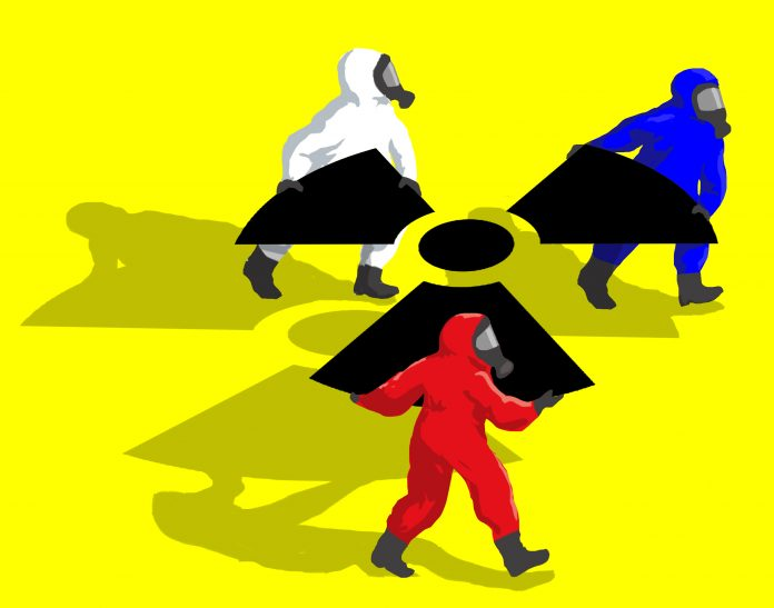 Illustration of three hazmat-suited figures carrying giant nuclear symbol (State Dept.)