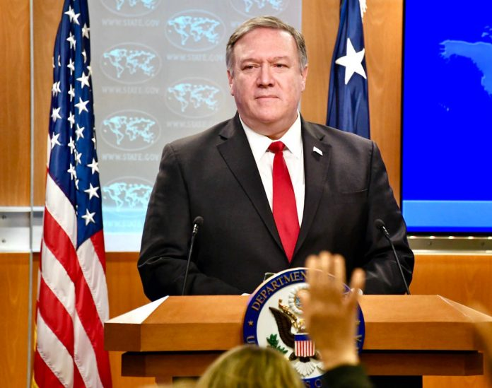 Secretary of State Mike Pompeo speaking at a lectern (State Dept./Michael Gross)