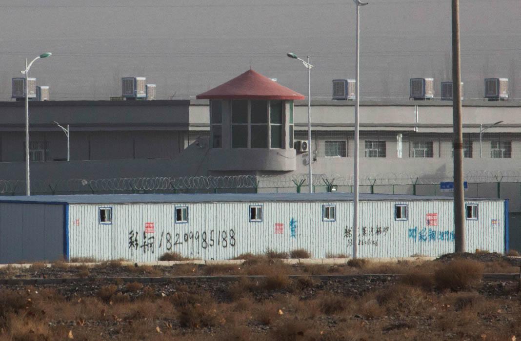 Buildings behind barbed wire (© Ng Han Guan/AP Images)