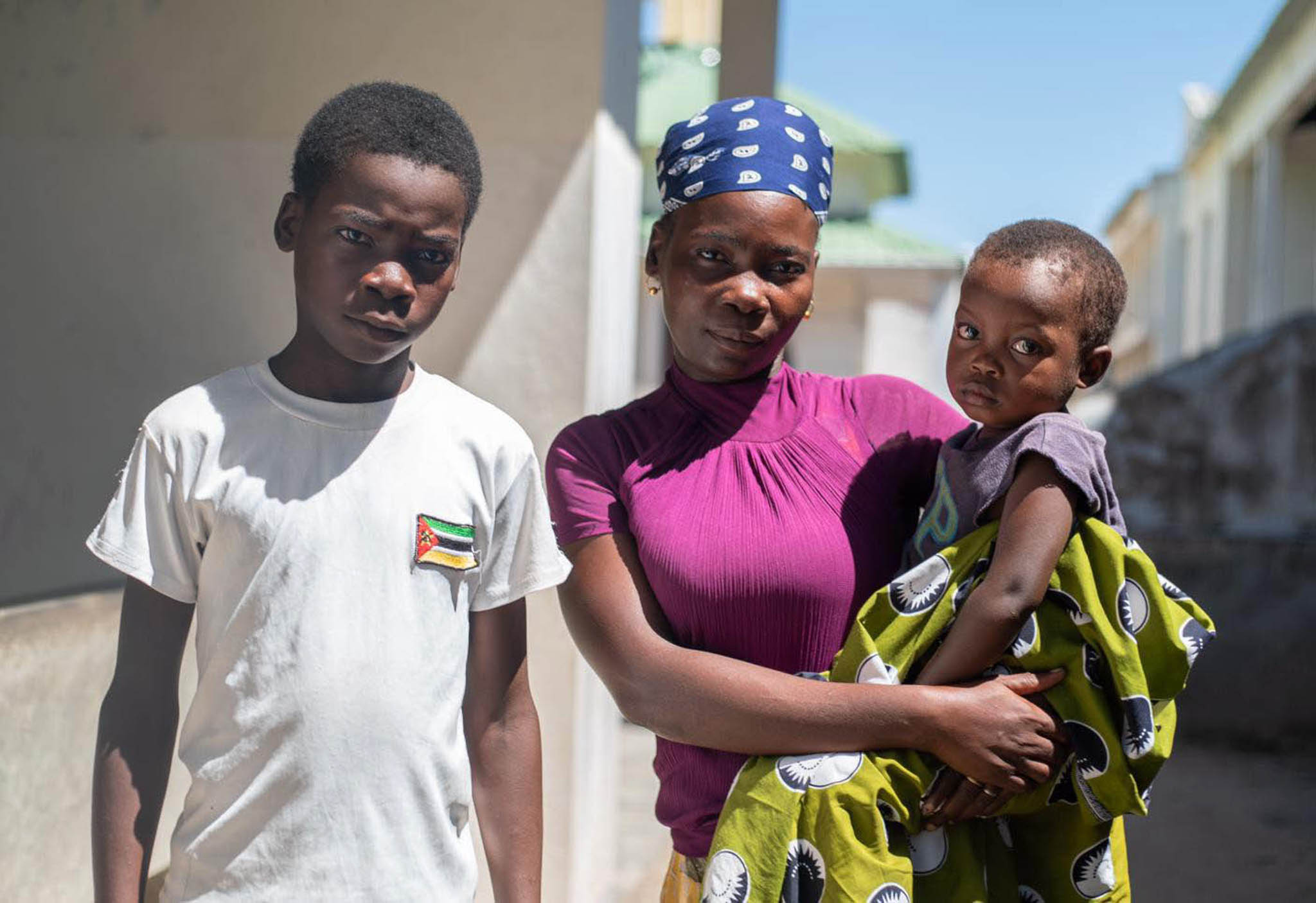 Woman holding a baby, with teenage boy standing next to them (World Vision UK)