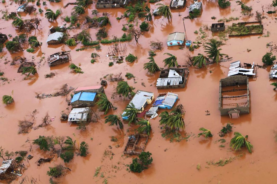 Aerial view of houses flooded by a cyclone (© Adrien Barbier/AFP/Getty Images)