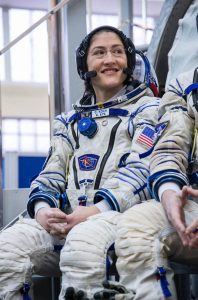 Smiling female astronaut in space suit (Beth Weissinger/NASA)