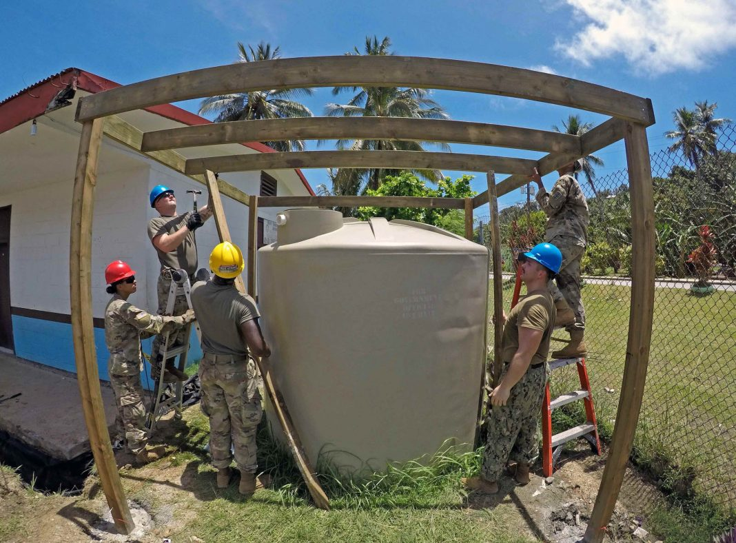 Military personnel building a catchment (Mass Communication Specialist 1st Class Tyrell K. Morris/U.S. Navy)