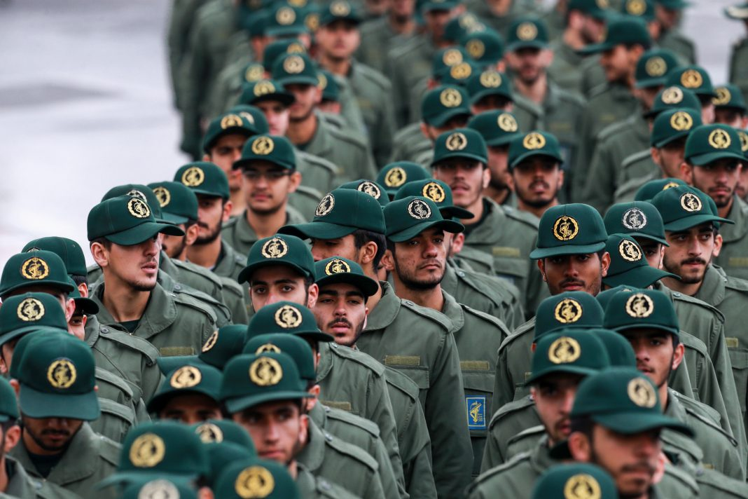 Lines of soldiers marching (© Vahid Salemi/AP Images)