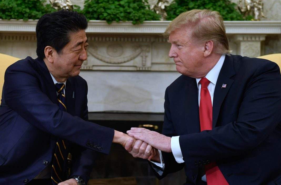 Shinzo Abe shaking hands with Donald Trump (© Susan Walsh/AP Images)