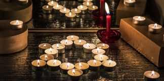 Candles in the shape of the Star of David (© Romans Klevcovs/Alamy)