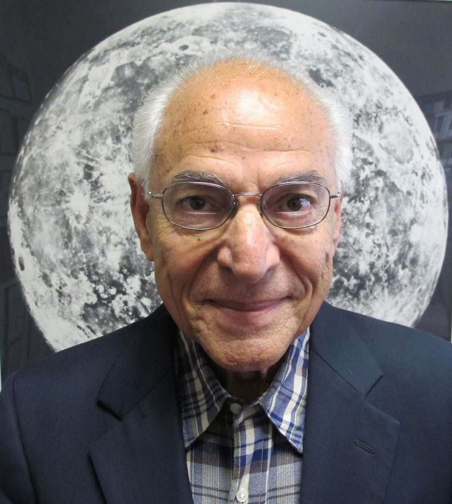 Farouk El-Baz in front of a picture of a moon (Courtesy photo)