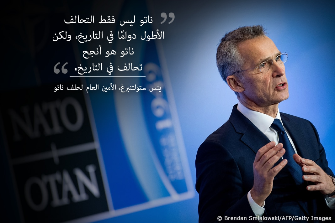 Photo of Jens Stoltenberg gesturing with superimposed quote by him on NATO (State Dept./© Brendan Smialowski/AFP/Getty Images)