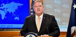 Secretary of State Mike Pompeo speaking at a lectern (State Dept.)