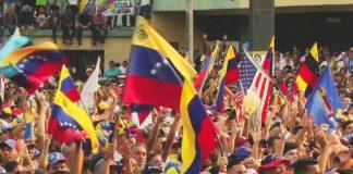 Crowd holding Venezuelan flags