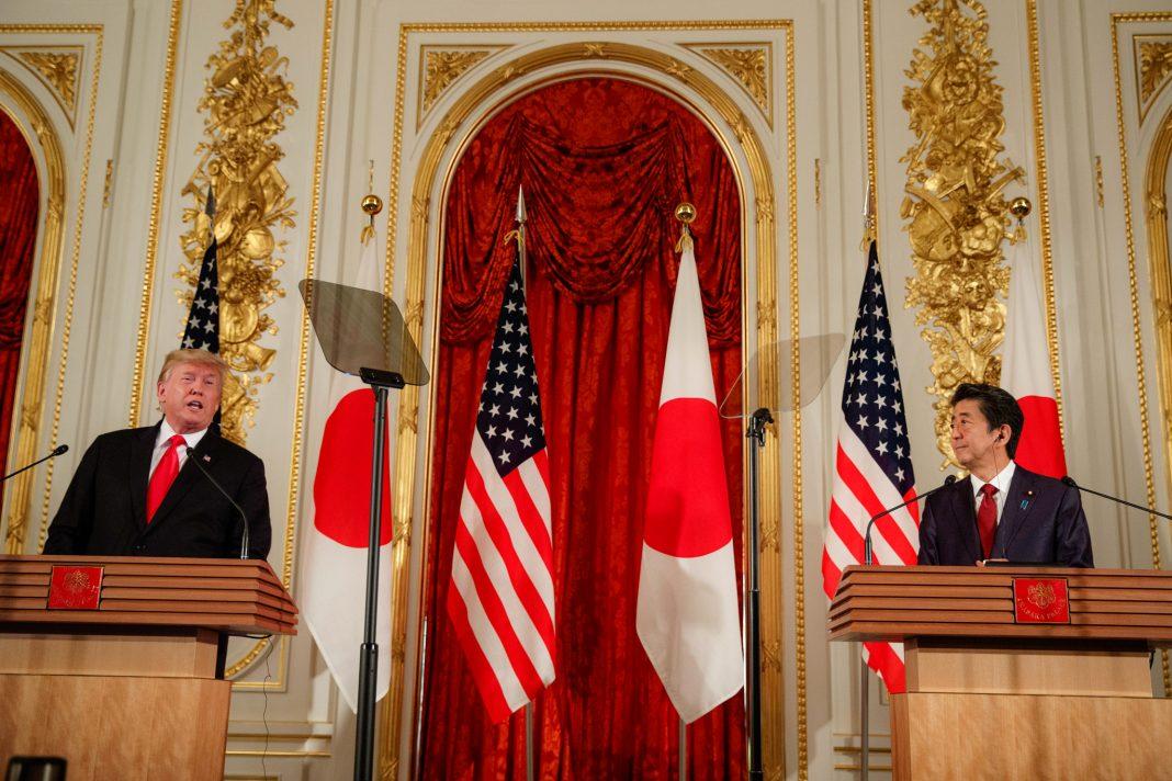 Donald Trump and Shinzō Abe standing at lecterns (© Evan Vucci/AP Images)